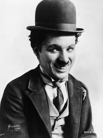 Charlie Chaplin smiling in a Coat and Tie