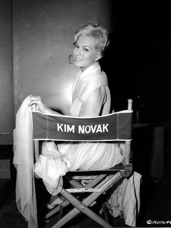 Kim Novak Siting on Chair in White Gown