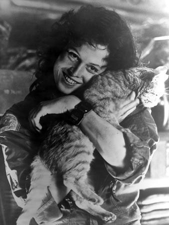 Sigourney Weaver Carrying Cat in Classic