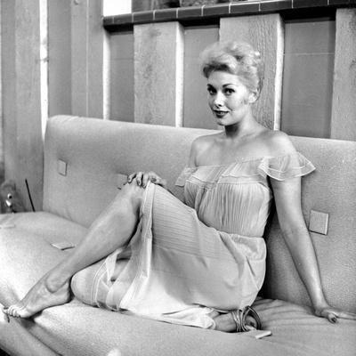 Kim Novak Siting on Bench in White Gown