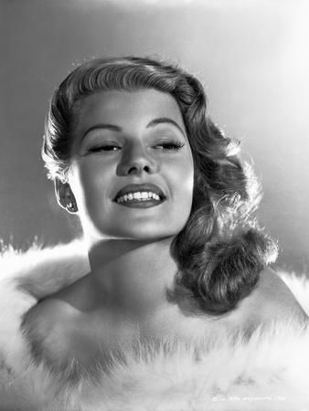 Rita Hayworth smiling with Fur Shawl