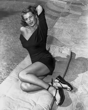 Rita Hayworth Posed with a Black Dress