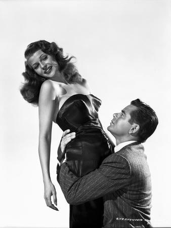 Rita Hayworth Held by a Man in Suit