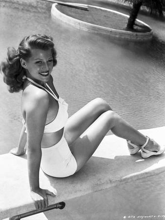 Rita Hayworth Seated on the Pool Side