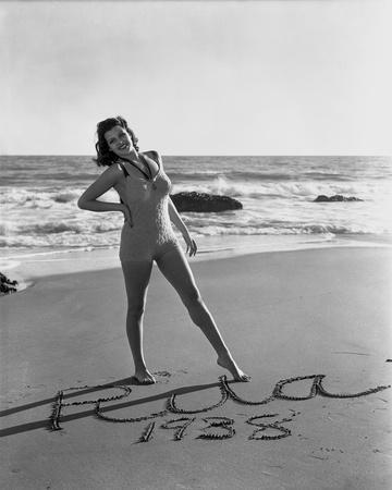 Rita Hayworth posed At the Beach