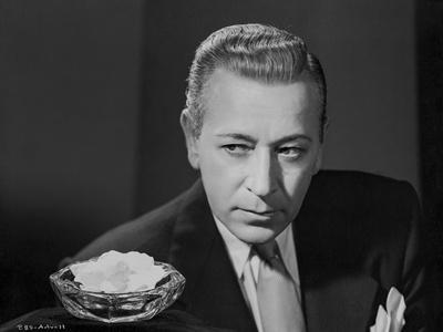 George Raft Posed in Coat and Tie