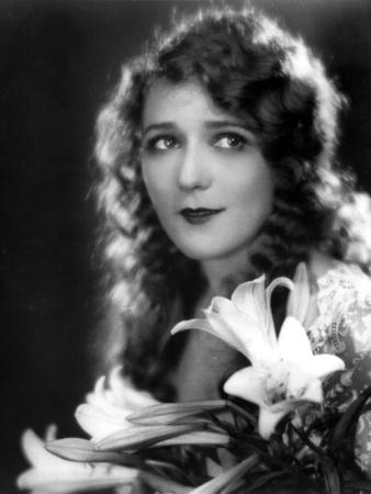 Mary Pickford Carrying a Flowers