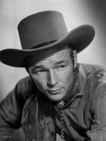 Roy Rogers posed in Cowboy Attire