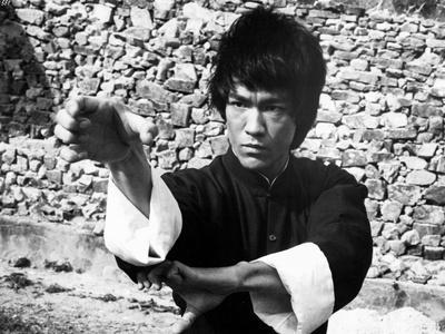 Bruce Lee wearing a Kung Fu Attire