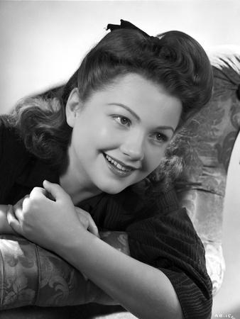 Anne Baxter Leaning and smiling