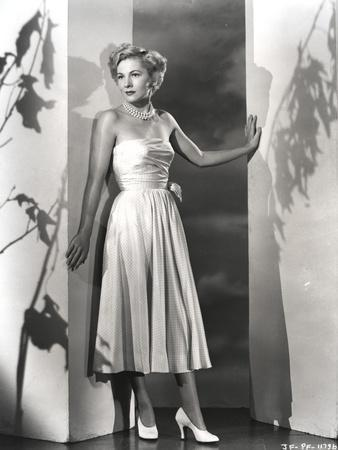 Joan Fontaine in Dress Leaning