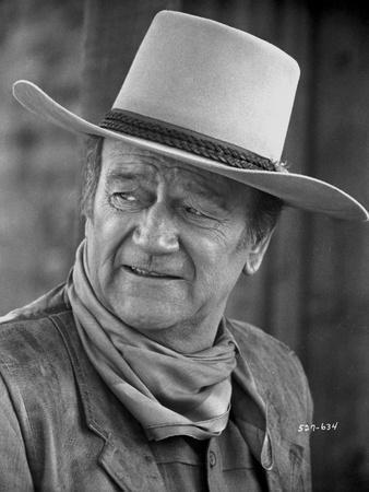 John Wayne Poses with a Hat