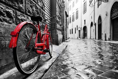 Retro Vintage Red Bike on Cobblestone Street in the Old Town. Color in Black and White. Old Charmin