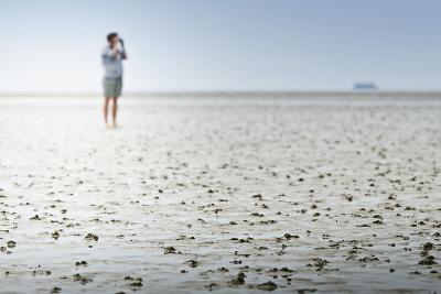 Germany, Schleswig-Holstein, Pellworm, Mud Flats, Woman