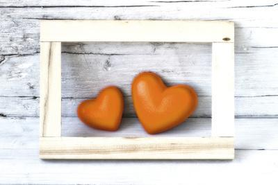 Two Hearts Made of Stone in Picture Frame