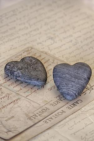 Heart Made of Stones with Old Postcard