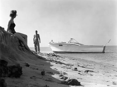 Couple Enjoying the Beach with their Chirs-Craft Boat