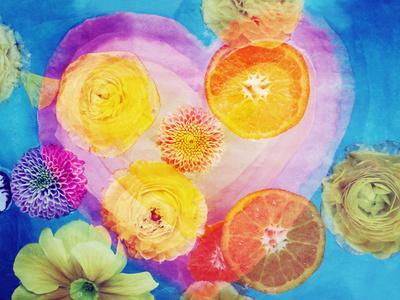 Composing of Blossoms and Slices of Orange Infront of Painted Heart