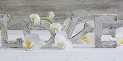Wooden Letters 'Love' with Orchid Blossoms