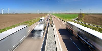 Germany, Saxony-Anhalt, Truck and Car in Motion Blur