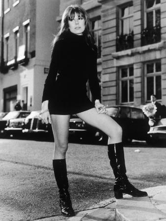 A Girl Wearing a Black Polo- Neck Mini-Dress and Black Knee-High Patent Boots