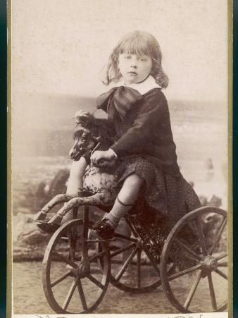 French Child on Splendid Horse-Tricycle