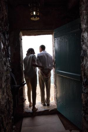 President Barack Obama and Michelle at the 'Door of No Return'