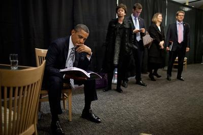 President Barack Obama Reviews Notes as His Staff Waits before an Event in Denver, Colorado