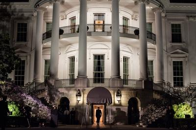 President Barack Obama Enters the South Portico of the White House at Night on March 30, 2012