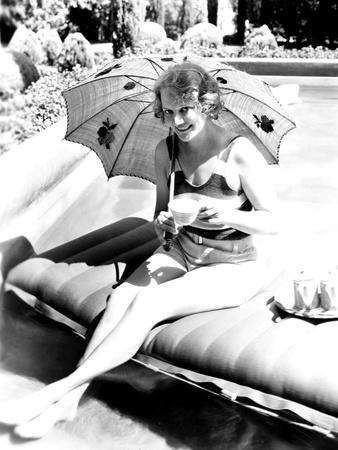 Minna Gombell, Sipping a Cup of Tea Poolside, 1931
