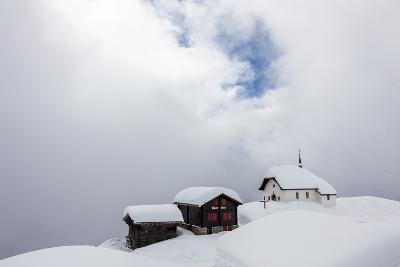 Snow Covered Mountain Huts and Church Surrounded by Low Clouds, Bettmeralp, District of Raron