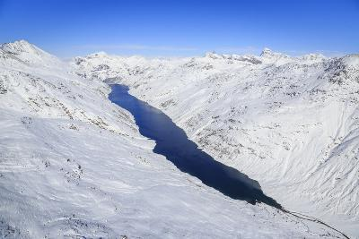 Aerial View of the Alpine Lago Di Lei Surrounded by Snow, Val Di Lei, Chiavenna