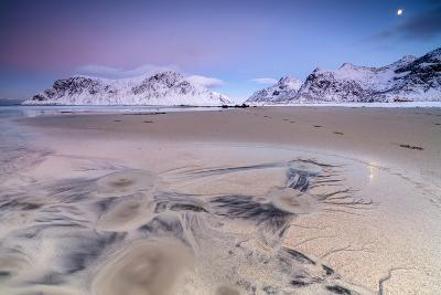 Full Moon Reflected on Sand in the Surreal Scenery of Skagsanden Beach, Flakstad, Nordland County