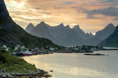Sunset on the Fishing Village Surrounded by Rocky Peaks and Sea, Reine, Nordland County