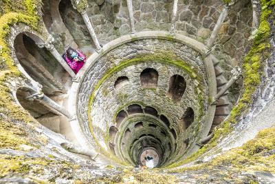 Photographer at Top of Spiral Stairs Inside Towers of Initiation Well at Quinta Da Regaleira