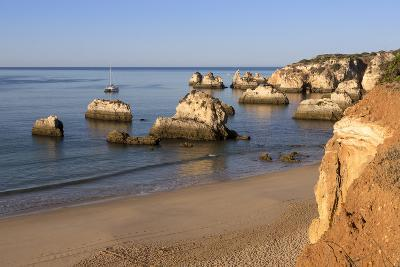View of the Fine Sandy Beach Bathed by the Blue Ocean at Dawn, Praia Do Alemao, Portimao