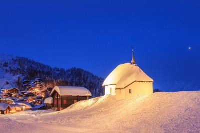Blue Dusk on the Alpine Village and Church Covered with Snow, Bettmeralp, District of Raron
