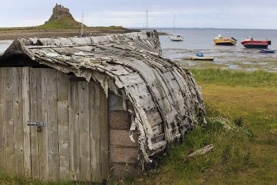Upturned Weathered Boat Hut with Lindisfarne Castle and Fishing Boats at Low Tide, Holy Island