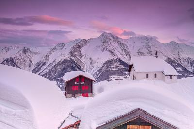 Pink Sky at Sunset Frames the Snowy Mountain Huts and Church, Bettmeralp, District of Raron