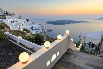 The Fiery Red Sky on the Aegean Sea after Sunset Seen from the Typical Terraces of Firostefani