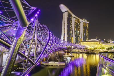 People Strolling on the Helix Bridge Towards the Marina Bay Sands and Artscience Museum at Night
