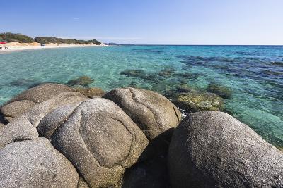 Rocks Frame the Turquoise Water of Sea around the Sandy Beach of Sant Elmo Castiadas, Costa Rei
