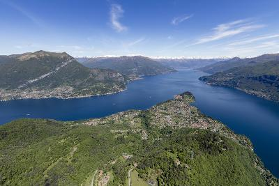 Aerial View of the Village of Bellagio Frames by the Blue Water of Lake Como on a Sunny Spring Day