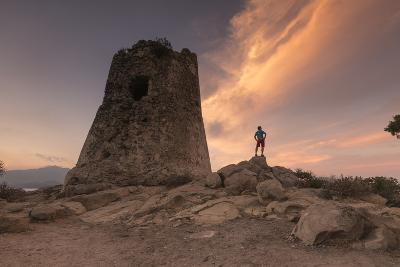 Hiker Admires Sunset from the Stone Tower Overlooking the Bay, Porto Giunco, Villasimius