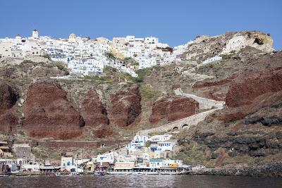 Typical Greek Village Perched on Volcanic Rock with White and Blue Houses and Windmills, Santorini