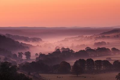 The Littondale Valley in Yorkshire Dales with Mist Lingering Among Trees in Light of Autumn Morning
