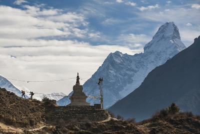 Trekkers Near a Chorten in the Everest Region with the Peak of Ama Dablam in the Distance