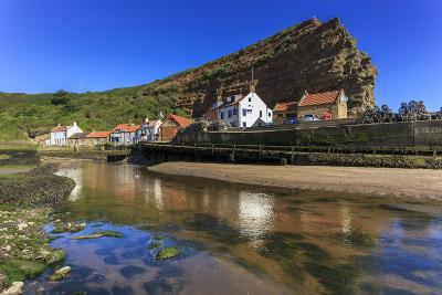 Harbour Cottages Beneath Steep Cliffs, Fishing Village, Low Tide in Summer