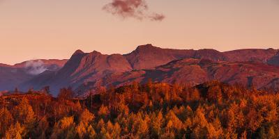 The Langdale Pikes Lit in Golden Glow of Dawn Light on Autumn Morning, Lake District National Park