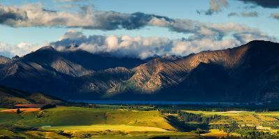 The Plains and Lakes of Otago Region Framed by Cloud Capped Mountains, Otago, South Island